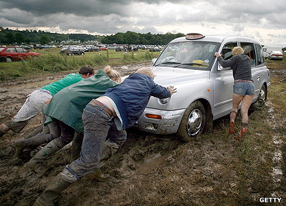 Taxi being dragged through mud