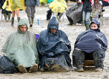 Men sitting in the mud