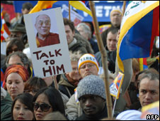 Pro-Tibet demonstrators hold a portrait of the Dalai Lama during a protest on 7 April 2008