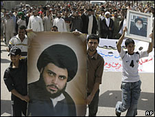 Iraqi protestors march in Baghdad carrying a poster of Moqtada Sadr, 4 April 2008
