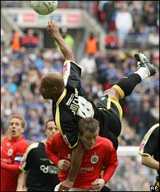 Cardiff's Trevor Sinclair challenges for the ball against Barnsley