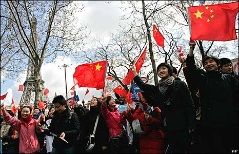 Spectators waving Chinese flags in front of Eiffel tower 7/4/08