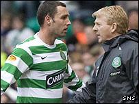 Scott McDonald storms past his manager Gordon Strachan