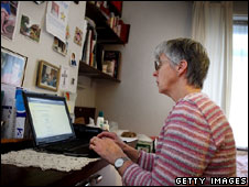 A pensioner uses her laptop at her London home