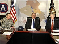 Washington's key leaders in Iraq, Gen Petraeus (left) and Ambassador Crocker (right), flank President Bush in Kuwait, 12 January 2008