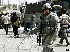 A US soldier secures a checkpoint in Baghdad on 7 April