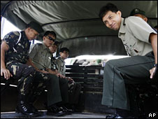 Gerardo Gambala (right) and Milo Maestrecampo (second left) sit in a military truck as they leave the court