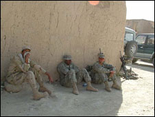 US soldiers take a break from a mission in Ghazni province
