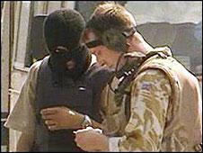 Iraqi interpreter and British soldier
