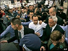 Israeli ex-President Moshe Katsav arrives at court to protests on Tuesday