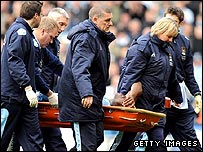 Nedum Onuoha is stretchered off at Man City on Saturday