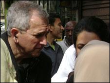 Bill Law talking to people in Egypt