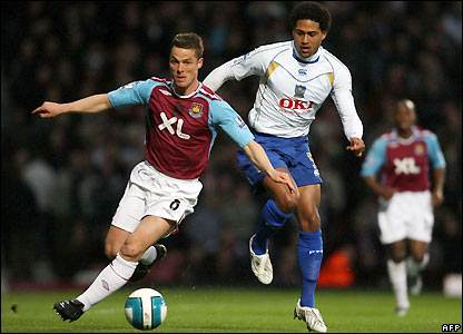 Parker is pursued by Glen Johnson