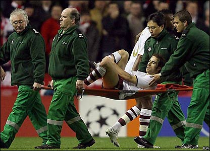 Mathieu Flamini is stretchered off