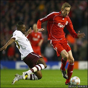 William Gallas prepares to tackle Peter Crouch