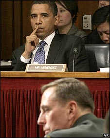 Barack Obama listens to Gen Petraeus speaking