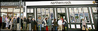 People queueing outside branch of Northern Rock bank
