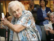 Pensioner playing Nintendo Wii, AP