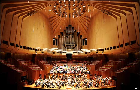 "The Sydney Symphony Orchestra and Sydney Opera House staff sing ""Happy Birthday"" to celebrate the 90th birthday of the Sydney Opera House's architect, Jorn Utzon"