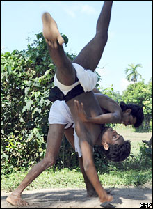 Sri Lankan men take part in a traditional martial art locally known as Angam Pora in Koratota village, outside the capital Colombo.