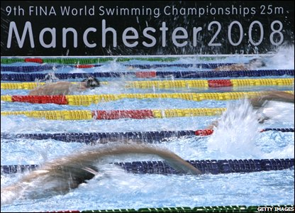 Swimmers take part in the men's 200m freestyle heats in Manchester