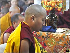 The Karmapa, the third-ranking Lama, front, attends a prayer session with the Dalai Lama at the Tsuglakhang temple in Dharmsala, India, Sunday, April 6, 2008