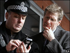 Kenny MacAskill with a police officer