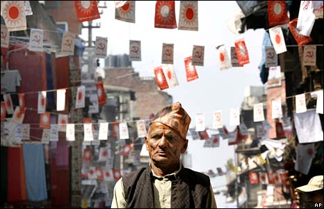A Nepalese man walks down a main street decorated with the flags of political parties contesting elections on Wednesday Kathmandu, Nepal