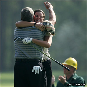 Jeana Finlinson is hugged by Fuzzy Zoeller