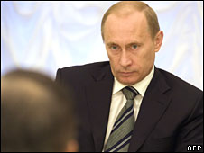 Russia's Vladimir Putin listens to UN Secretary General Ban Ki-moon at the Kremlin on 9 April 2008
