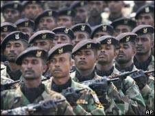 Special forces, one of Sri Lanka's elite fighting forces, march during a parade to celebrate Sri Lanka's 60th Independence Day