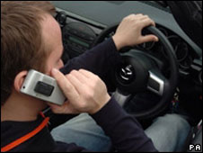 Man driving while talking on mobile phone