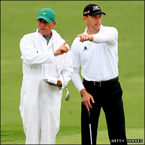Soren Hansen and his caddie John Graham point in different directions