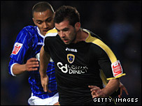Ipswich's Danny Simpson challenges Cardiff's Joe Ledley