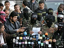 Militants speak to reporters in Gaza City after the border raid