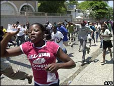 Haitians run through the streets during protests against the rising cost of living in Port-au-Prince on 8 April, 2008
