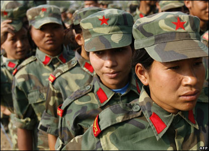 Maoist soldiers line up to cast their ballots