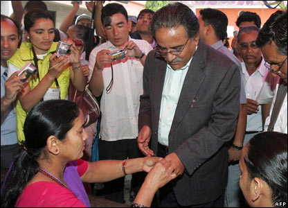 An election official marks the hand of former rebel leader and present chairman of the Nepal Communist Party (Maoist) Pushpa Kamal Dahal, better known as Prachanda.