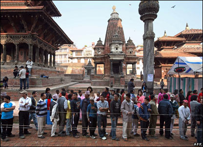 Nepalese men queue to cast their ballots in Kathmandu