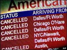 A board at Portland International Airport shows cancelled American Airlines flights, 9 April 2008