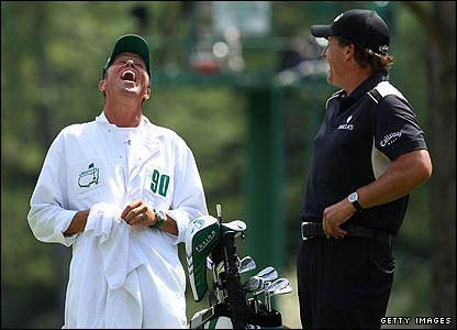 Phil Mickelson shares a joke with his caddy