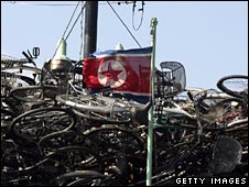 A North Korean flag on a cargo boat loaded with bicycles on 13 October 2006