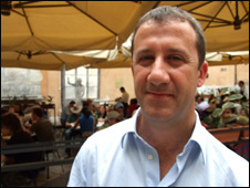 Fabio Conticello stands in front of his restaurant in Palermo