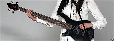 Peaches Geldof playing bass guitar