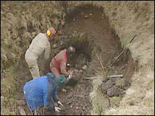 Workers fill the cave in