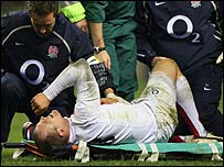 Mike Tindall being stretchered off against Wales