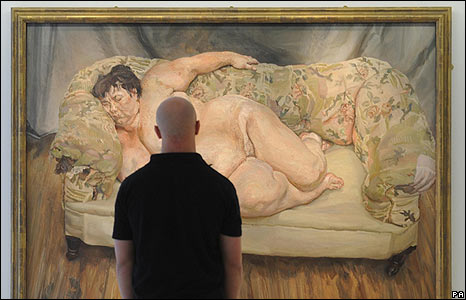 A man looking at a painting