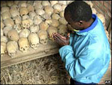 A survivor prays at a mass grave (Archive picture)