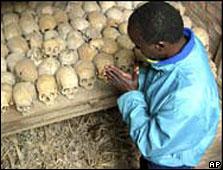 A survivor prays at a mass grave (Archive picture)