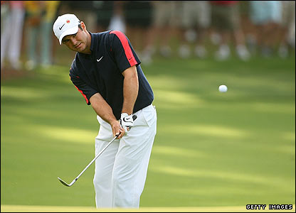 South Africa's Trevor Immelman pitches to the first green during the second round